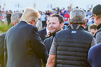 President Trump visits with Brandon Grace (RSA) following  round 4 Singles of the 2017 President's Cup, Liberty National Golf Club, Jersey City, New Jersey, USA. 10/1/2017. <br /> Picture: Golffile | Ken Murray<br /> <br /> All photo usage must carry mandatory copyright credit (&copy; Golffile | Ken Murray)