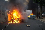 © Joel Goodman - 07973 332324 . 08/08/2011 . London , UK . Van and wheelie bin set alight on the Pembury Estate in Hackney during a 3rd night of rioting and looting in London , which followed a protest against the police shooting of Mark Duggan in Tottenham . Photo credit : Joel Goodman