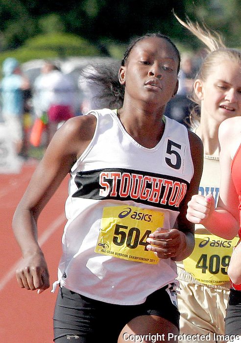 Stoughton High's Jade Paul runs in of the 800 meter race during the 2011 All-State Outdoor Track meet on Saturday at Bridgewater State University..(Photo by Gary Wilcox).