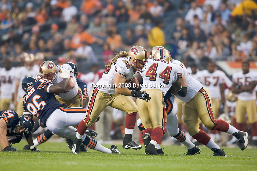 Running back Zak Keasey #45 of the San Francisco 49ers carries the ball against the Chicago Bears at Soldier Field on August 21, 2008 in Chicago, Illinois. The 49ers defeated the Bears 37-30. (AP Photo/David Stluka)