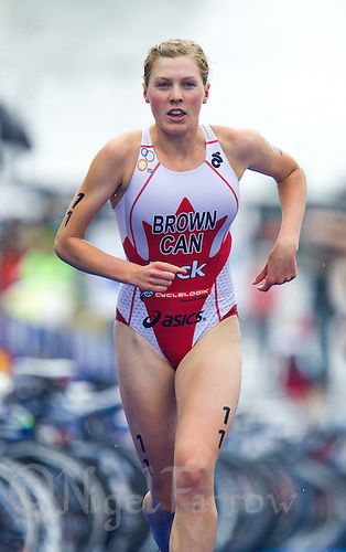 26 AUG 2012 - STOCKHOLM, SWE - Joanna  Brown (CAN) of Canada  heads through transition for the start of her run leg during the 2012 ITU Mixed Relay Triathlon World Championships in Gamla Stan, Stockholm, Sweden (PHOTO (C) 2012 NIGEL FARROW)