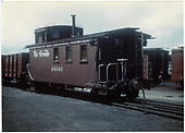 End-side view of long caboose #04343, flying herald.<br /> D&amp;RGW
