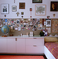A board for cards, notices, photographs and other memorabilia has been incorporated into the wall of this child's bedroom