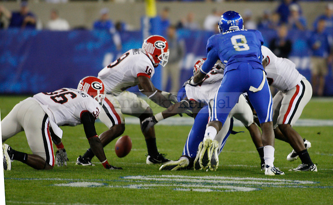 The University of Georgia forces on of many fumbles that plagued UK in the first half at Commonwealth Stadium on Saturday, Oct. 23, 2010. Photo by Scott Hannigan | Staff