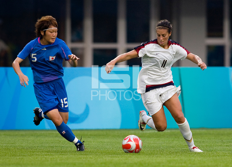 Carli Lloyd, Mizuho Sakaguchi. The US defeated Japan, 1-0, during the 2008 Beijing Olympics in Qinhuangdao, China.