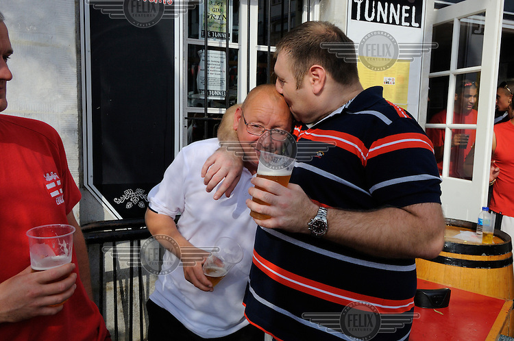 Drinkers getting sentimental outside a pub during  during celebrations on Gibraltar National Day.