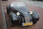 Burton brand self-assembly kit open top car parked on street Netherlands