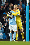 Joe Hart of Manchester City celebrates qualifying for the next round during the UEFA Champions League match at the Etihad Stadium. Photo credit should read: Philip Oldham/Sportimage
