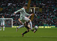 Gary Hooper being tackled by Jon Robertson in the Celtic v St Mirren Clydesdale Bank Scottish Premier League match played at Celtic Park, Glasgow on 15.12.12.