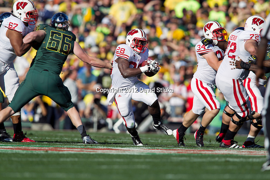 Wisconsin Badgers running back Montee Ball (28) carries the ball during the 2012 Rose Bowl NCAA football game against the Oregon Ducks in Pasadena, California on January 2, 2012. The Ducks won 45-38. (Photo by David Stluka)