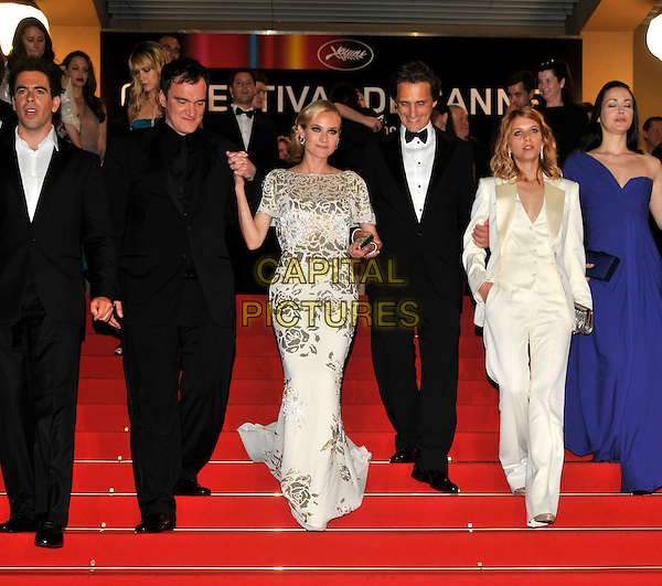"QUENTIN TARANTINO, DIANE KRUGER, LARWRENCE BENDER, MELANIE LAURENT, JULIE DREYFUS .Leaving the premiere of ""Inglorious Basterds""  at the Grand Theatre Lumiere  during the 62nd Cannes International Film Festival, Cannes, France, .May 20th 2009..full length departures black suit cast holding hands walking steps blue one shoulder dress white silver foil print trouser suit cream tux tuxedo floral .CAP/PL.©Phil Loftus/Capital Pictures"