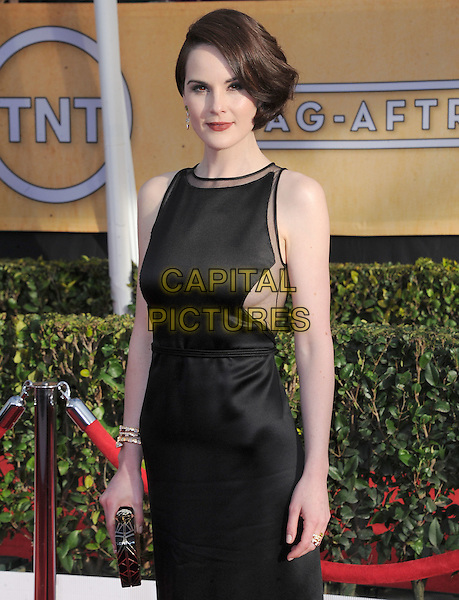 Michelle Dockery (wearing Ralph Rucci).Arrivals at the 19th Annual Screen Actors Guild Awards at the Shrine Auditorium in Los Angeles, California, USA..27th January 2013.SAG SAGs half length black sleeveless dress clutch bag side bob cleavage sheer .CAP/DVS.©DVS/Capital Pictures.