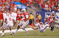Ohio State Buckeyes wide receiver Corey Smith (84) throws a block on Wisconsin Badgers linebacker Joe Schobert (58) that got him ejected as Ohio State Buckeyes quarterback Cardale Jones (12) runs toward Wisconsin Badgers cornerback Sojourn Shelton (8) in the second quarter of the Big Ten Championship game at Lucas Oil Stadium in Indianapolis on Saturday, December 6, 2014. (Columbus Dispatch photo by Jonathan Quilter)