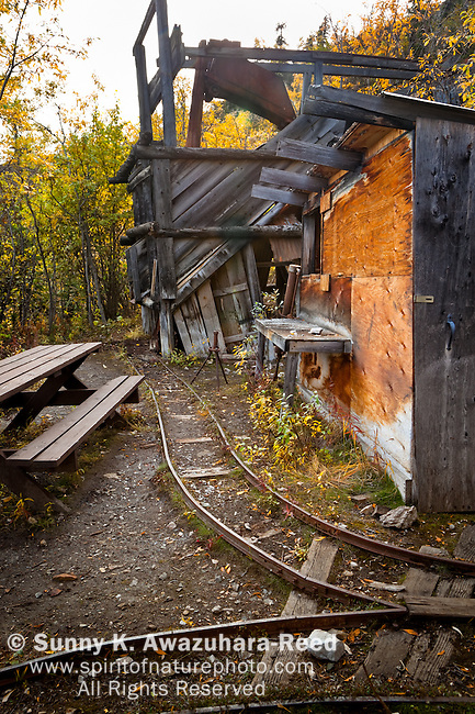 The remains of the abandoned Rambler Mine, Nabesna Road, Wrangell - St. Elias National Park & Preserve, Southcentral Alaska, Autumn.
