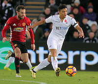 Wayne Routledge of Swansea City (R) is chased by Juan Mata of Manchester City during the Premier League match between Swansea City and Manchester United at The Liberty Stadium, Swansea, Wales, UK. Sunday 06 November 2016