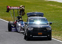 May 31, 2014; Englishtown, NJ, USA; The dragster of NHRA top fuel driver Leah Pritchett is towed back to the pits during qualifying for the Summernationals at Raceway Park. Mandatory Credit: Mark J. Rebilas-
