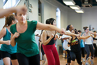 Exercisers participate in an exercise class at the Metropolitan Recreation Center in Brooklyn in New York on Tuesday, January 10, 2012 as part of the Parks & Recreation Dept. Shape Up NYC free fitness classes. The city is offering a free 8 week program to encourage physical activity and overall wellness in the recreation centers in the five boroughs. Participants are weighed and measured prior to starting the program with prizes to be awarded to the most successful on March 2, the end of Shape Up NYC. (© Richard B. Levine)