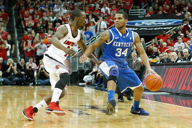 UK guard Julius Mays (34) dribbles the ball against UofL guard Russ Smith (2) during the first half of the UK Men's basketball game vs. University of Louisville at KFC Yum! Center in Louisville, Ky., on Saturday, December 29, 2012. U of L won 80-77. Photo by Tessa Lighty | Staff