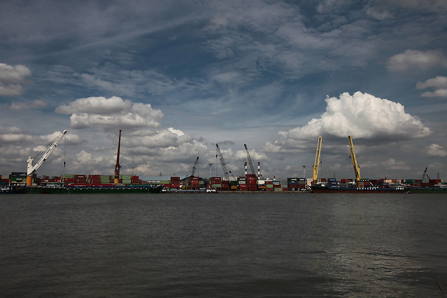 Loading cranes point skyward at a container port on the Saigon River outside Ho Chi Minh City, Vietnam. Aug 11, 2011.