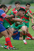 M. Tatafu tries to break through the tackle of R. Avei.  Counties Manukau Premier Club Rugby, Ardmore Marist vs Waiuku played at Bruce Pulman Park, Papakura on the 29th of April 2006. Ardmore Marist won 10 - 9.
