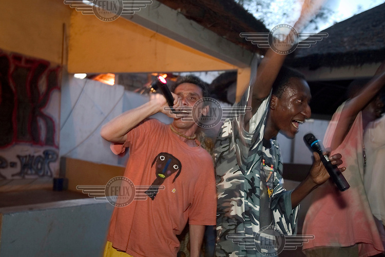 Manu Chao (left), a folk singer of Spanish origin, performing with local musicians in Bamako. Chao was in Bamako to work with local world music stars Amadou and Mariam.