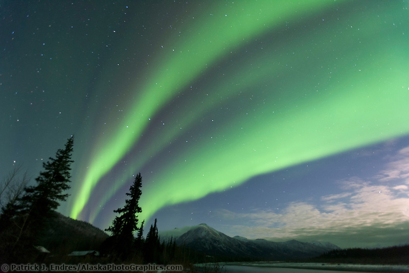 Aurora borealis over Midnight Dome mountain, Brooks Range, Alaska.