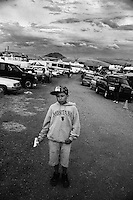 Skylar, 12,  poses in a parking area at the Rocky Boy Powwow in Rocky Boy's Indian Reservation, Montana, USA.