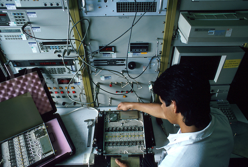 Technician evaluating final production of electronic instrument. Chihuahua Chihuahua Mexico.