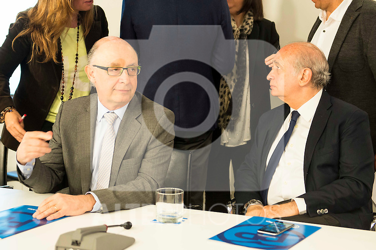 Cristobal Montoro and Jorge Fernandez Diaz during the meeting with the national executive committee of Partido Popular at Genova in Madrid. May 03, 2016. (ALTERPHOTOS/Borja B.Hojas)