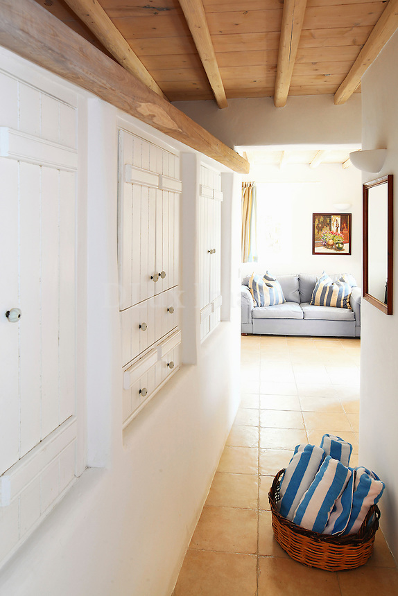 white cupboards in the hallway