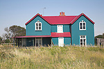 An unusual red and blue corrugated iron house, Bawdsey, Suffolk, England