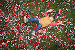 © Joel Goodman - 07973 332324 . 25/04/2015 . Salford , UK . A boy rolls in black red and white confetti , spread over the pitch , after the match . Evostick League champions , Salford FC , play Osset Town , in Salford . Photo credit : Joel Goodman
