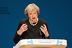 © Joel Goodman - 07973 332324 . 02/10/2016 . Birmingham , UK . THERESA MAY addresses the Conservative Party conference during the first day of the Conference at the International Convention Centre in Birmingham . Photo credit : Joel Goodman