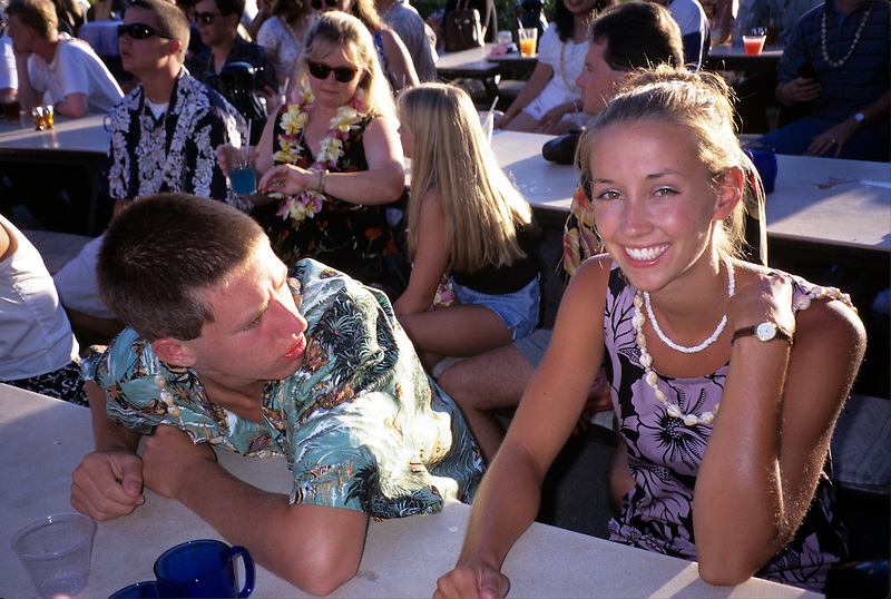 Teenagers at a luau in Maui, Hawaii.