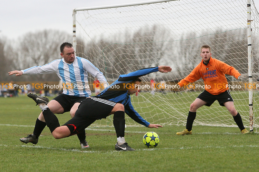 Inter Moore (blue/black stripes) vs Arbour Athletic (light blue/white stripes) - East London Sunday League at South Marsh, Hackney Marshes - 06/02/11 - MANDATORY CREDIT: Gavin Ellis/TGSPHOTO - Self billing applies where appropriate - Tel: 0845 094 6026