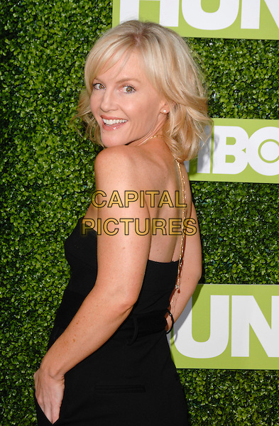 """RACHAEL HARRIS.The Premiere Of """"Hung"""" held at Paramount Studios, Los Angeles, California, USA. .June 24th, 2009 .half length rachel black strapless dress looking over shoulder .CAP/ROT.©Lee Roth/Roth Stock/Capital Pictures"""