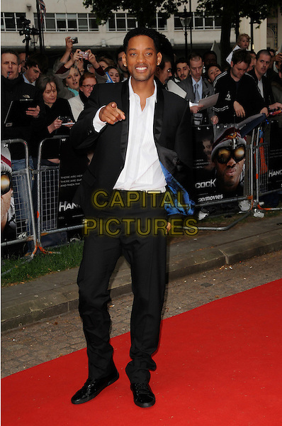 "WILL SMITH .Attending the UK Gala Premiere of ""Hancock"" held at the Vue West End, Leicester Square, London, England..June 18th 2008.full length black suit white shirt hand pointing .CAP/CAS.©Bob Cass/Capital Pictures."