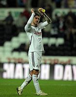 Pictured: Danny Graham of Swansea thanking supporters after the final whistle. Tuesday 27 December 2011<br /> Re: Premier League football Swansea City FC v Queens Park Rangers at the Liberty Stadium, south Wales.