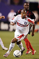 The Chicago Fire's Andy Williams with the ball as the MetroStars' Fabian Taylor trails. The Chicago Fire played the NY/NJ MetroStars to a one all tie at Giant's Stadium, East Rutherford, NJ, on May 15, 2004.