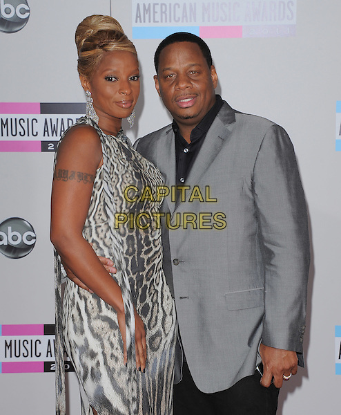 Mary J. Blige & Kendu Isaacs.2011 American Music Awards held at The Nokia Theater Live in Los Angeles, California, USA..November 20th, 2011.ama amas ama's half length grey gray beige leopard animal print one sleeve dress suit married husband wife .CAP/RKE/DVS.©DVS/RockinExposures/Capital Pictures.