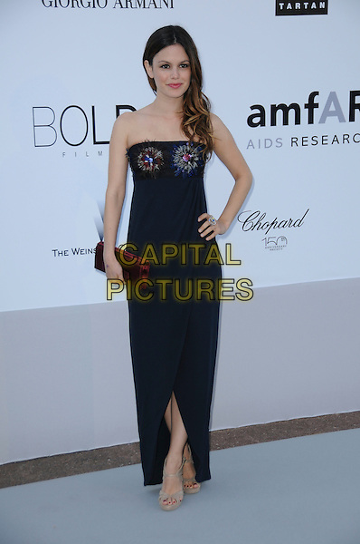 RACHEL BILSON.arrivals at amfAR's Cinema Against AIDS 2010 benefit gala at the Hotel du Cap, Antibes, Cannes, France during the Cannes Film Festival.20th May 2010.amfAR full length long maxi blue dress hand on hip navy blue beaded bodice feathers feather clutch bag red clutch bag beige sandals .CAP/CAS.©Bob Cass/Capital Pictures.