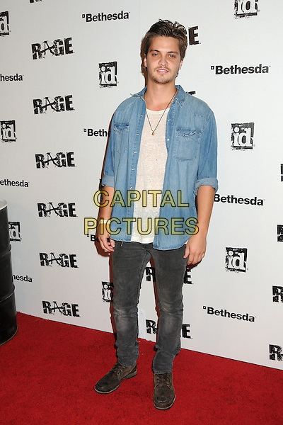 "Luke Grimes.""Rage"" Video Game Launch Party held in Chinatown's Historical Central Plaza, Los Angeles, California, .30th September 2011..full length denim shirt white t-shirt  grey gray denim jeans .CAP/ADM/BP.©Byron Purvis/AdMedia/Capital Pictures."
