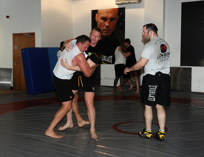 Photo: Tony Oudot/Richard Lane Photography. London Wasps train at the Hooks Gym in Acton. 12/03/2012. Heinz Koll and Lee Robinson wrestle.