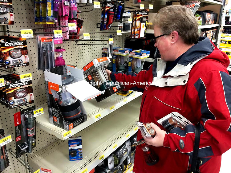 TORRINGTON, CT, 26 JAN 15 - Gloria Ozzone, of Torrington, stocks up on batteries and a battery-powered lantern at Wal-Mart Monday in preparation of a forecasted blizzard. The store was out of 5-gallon gas cans and ice melt by 10 a.m.   Alec Johnson/ Republican-American