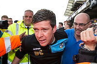Bristol Rovers manager Darrell Clarke struggles through a pitch invasion after the Sky Bet League 2 match between Bristol Rovers and Dagenham and Redbridge at the Memorial Stadium, Bristol, England on 7 May 2016. Photo by Mark  Hawkins / PRiME Media Images.