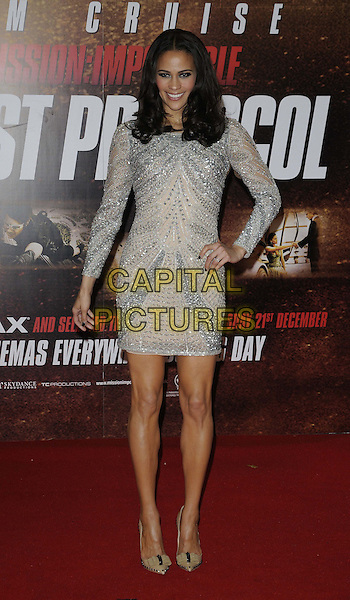"Paula Patton.The ""Mission : Impossible Ghost Protocol"" UK premiere, BFI Imax cinema,  Waterloo, London, England..December 13th, 2011.Mi4 MI:4 full length silver beige grey gray beads beaded dress hand on hip .CAP/CAN.©Can Nguyen/Capital Pictures."