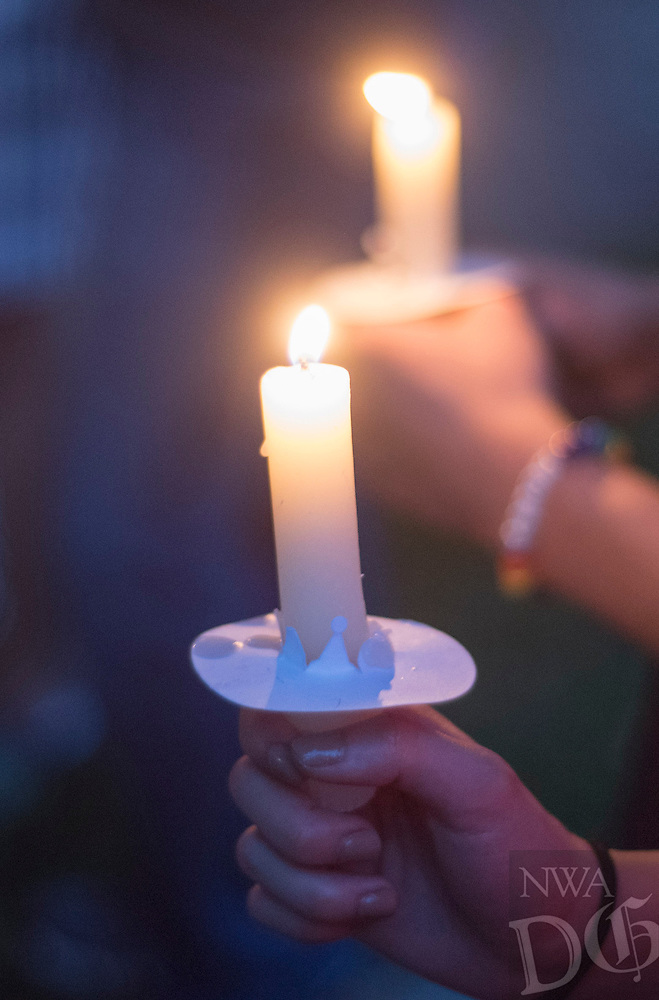 NWA Democrat-Gazette/J.T. WAMPLER Participants hold candles Sunday June 12, 2016 at St. Paul's Episcopal Church in Fayetteville during a vigil for the victims of the Orlando shooting. Around 500 people attended the vigil and marched down Dickson St.