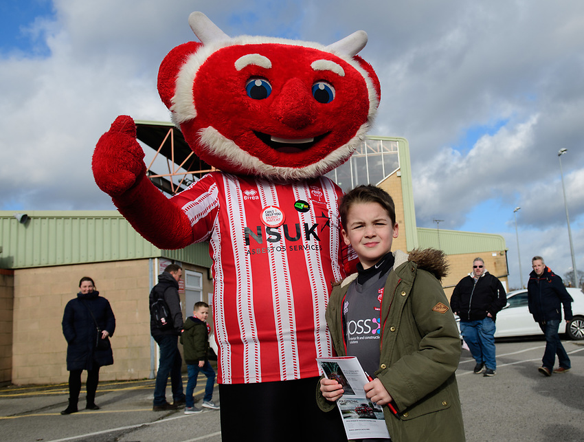 Lincoln City mascot Poacher the Imp with fans before kick off<br /> <br /> Photographer Chris Vaughan/CameraSport<br /> <br /> The EFL Sky Bet League Two - Lincoln City v Northampton Town - Saturday 9th February 2019 - Sincil Bank - Lincoln<br /> <br /> World Copyright © 2019 CameraSport. All rights reserved. 43 Linden Ave. Countesthorpe. Leicester. England. LE8 5PG - Tel: +44 (0) 116 277 4147 - admin@camerasport.com - www.camerasport.com