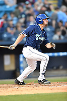 Asheville Tourists first baseman Chad Spanberger (24) swings at a pitch during a game against the Columbia Fireflies at McCormick Field on April 12, 2018 in Asheville, North Carolina. The Fireflies defeated the Tourists 7-5. (Tony Farlow/Four Seam Images)