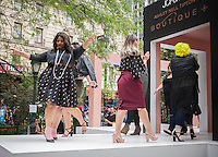 "JCPenney presents a fashion show of clothing for plus sized women created by designer Ashley Nell Tipton in Greeley Square in New York on Tuesday, September 6, 2016. Tipton is partnering with the department store in a plus-sized line for JCPenney's ""Boutique+"" brand. Tipton was the winner of season 14 of Project Runway. (© Richard B. Levine)"